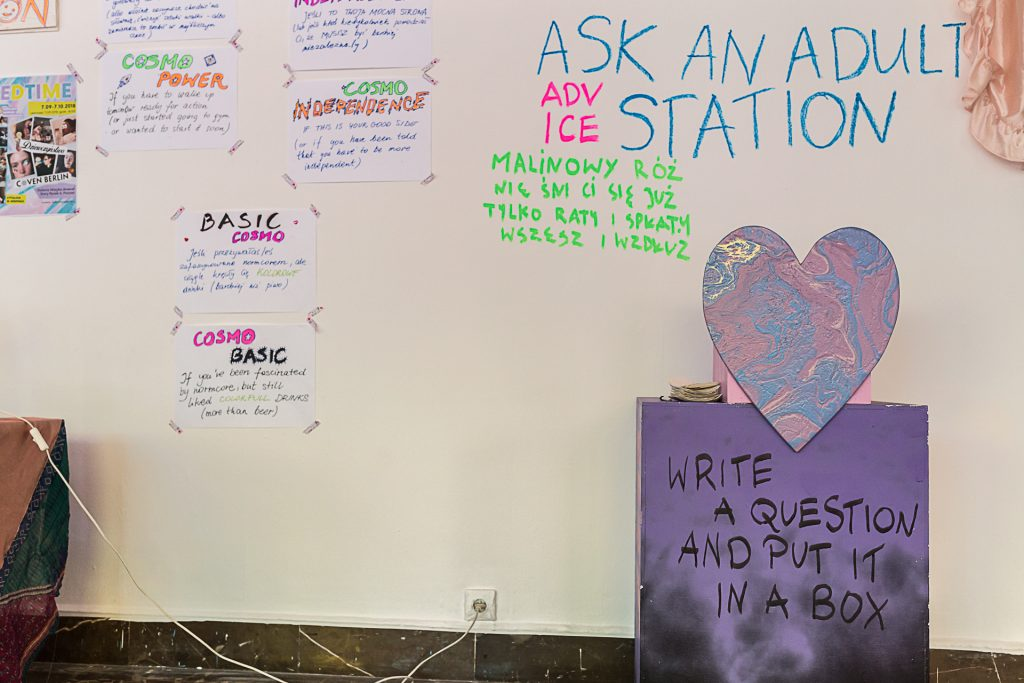 Exhibition view of a wall and text reading