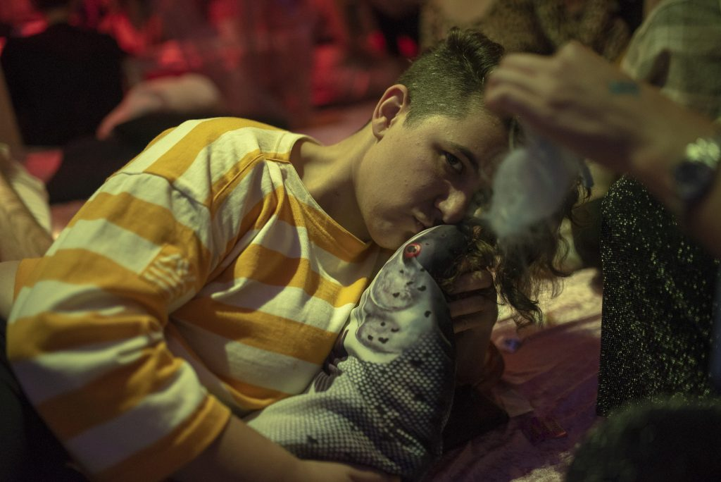 Someone holding and kissing a stuffed fish.