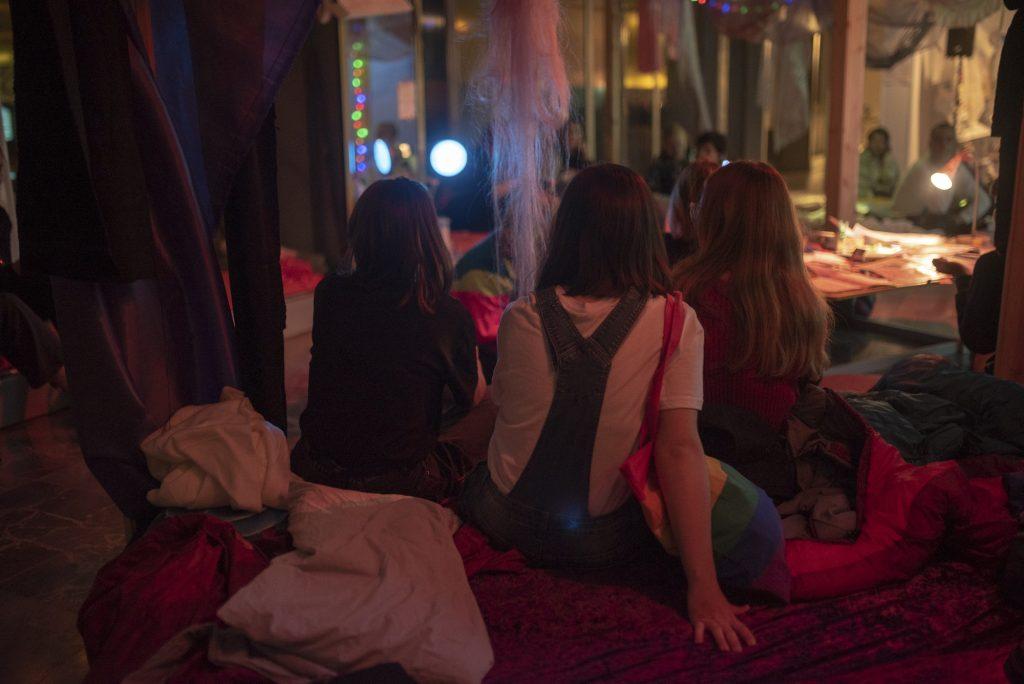 People sitting watching something.
