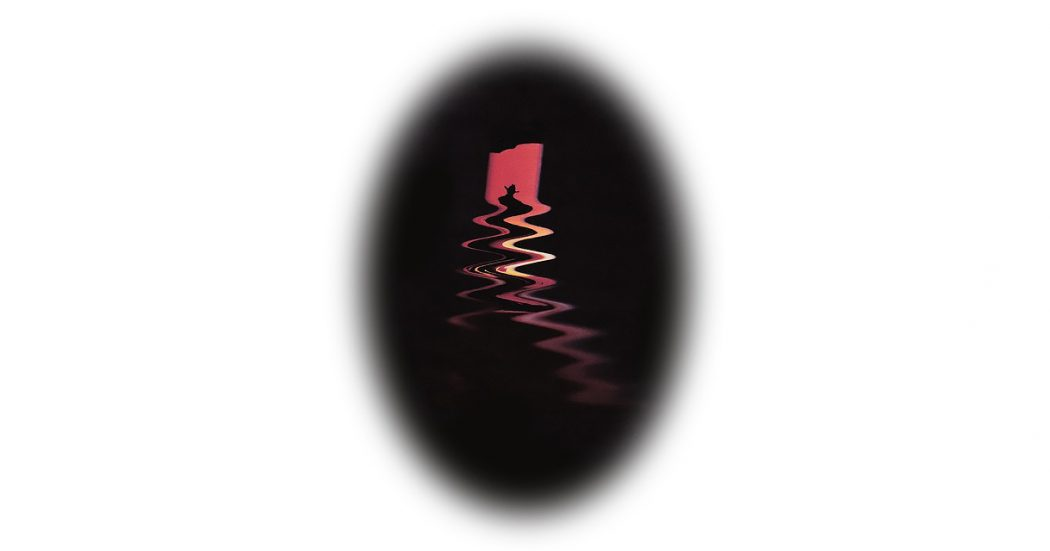 A vertical oval black shape on a white background. Inside the solid black oval, a red orange shape similar to a rock formation or brushstroke disappears into a stylized zig zag pattern that looks like reflections of light on water. At the top of the shape, the black outline of a person wearing a cowboy hat is visible. The black oval has feathered edges.