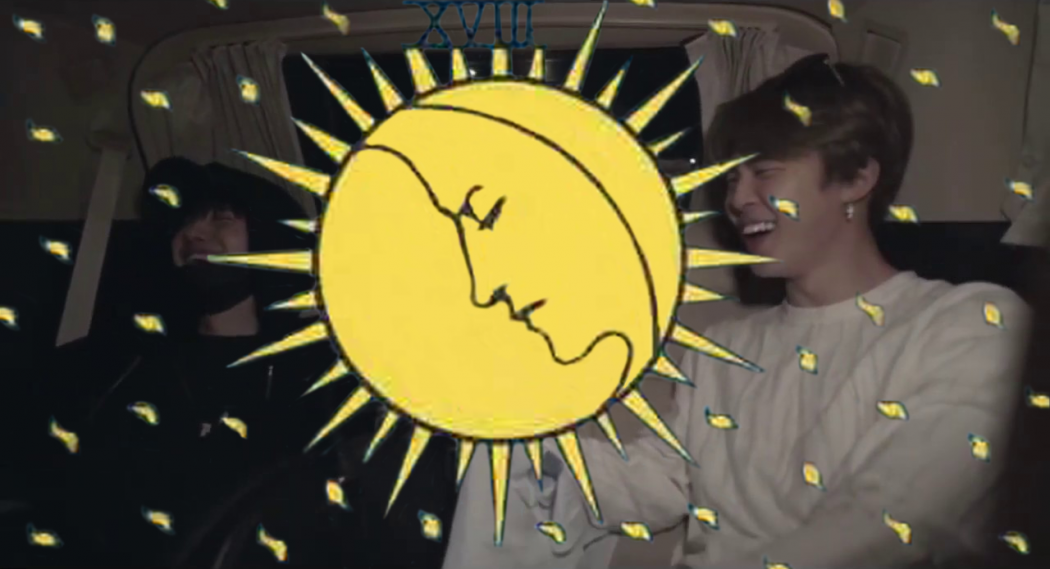 An image of Yoongi and Jimin from BTS, with a moon and flecks of light taken from the Ryder Waite tarot deck in yellow superimposed over the top of the image.
