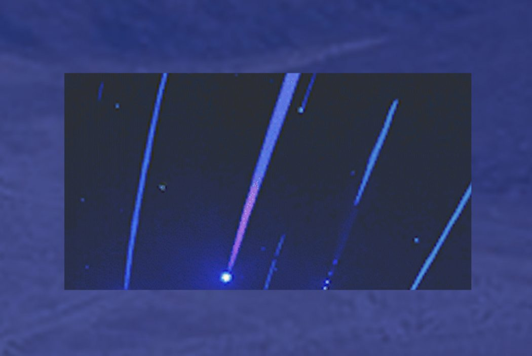 An illustrated image of shooting stars, with a band of lighter color around the edge. The image is in blues and purples.