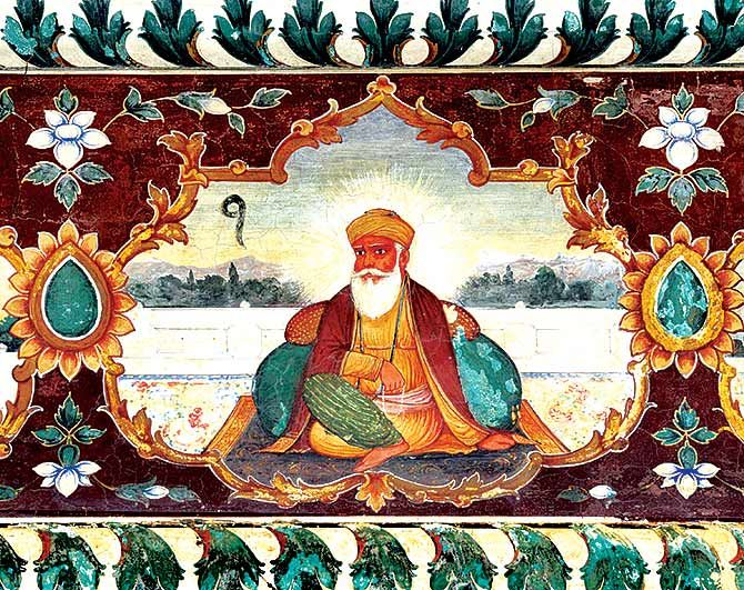 Colourful Painting of Guru Nanak, founder of Sikhism, in meditative pose surrounded by ornaments